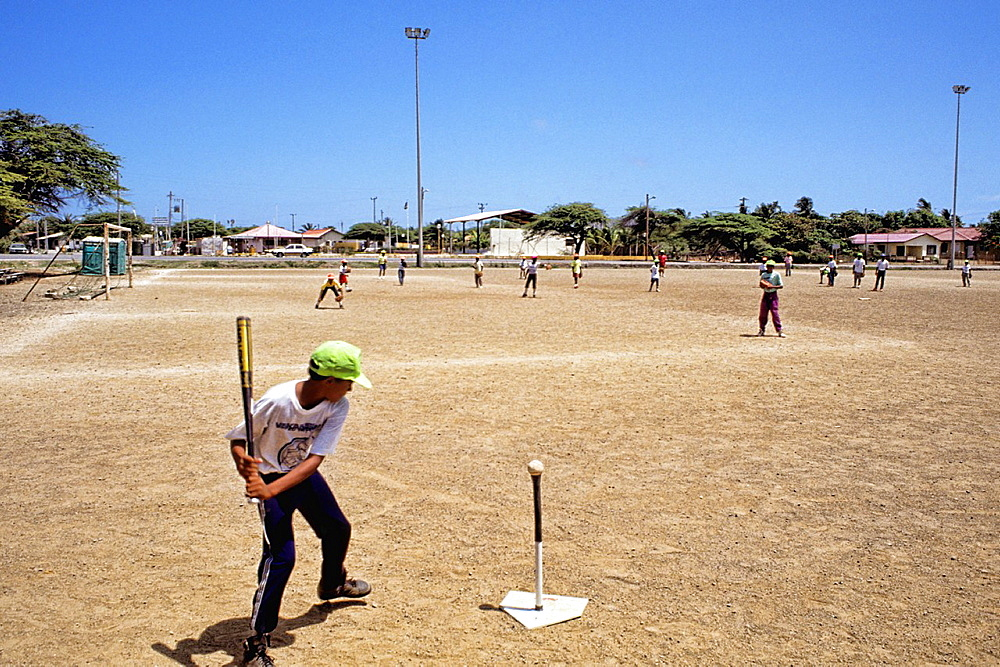Passion of baseball crazy teens practicing hitting in Curacao Caribbean