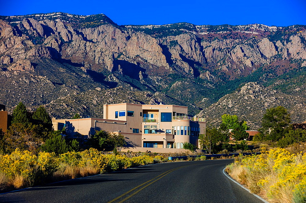Houses on Simms Park Road with the Sandia Mountains Cibola National Forest in background, Albuquerque, New Mexico USA