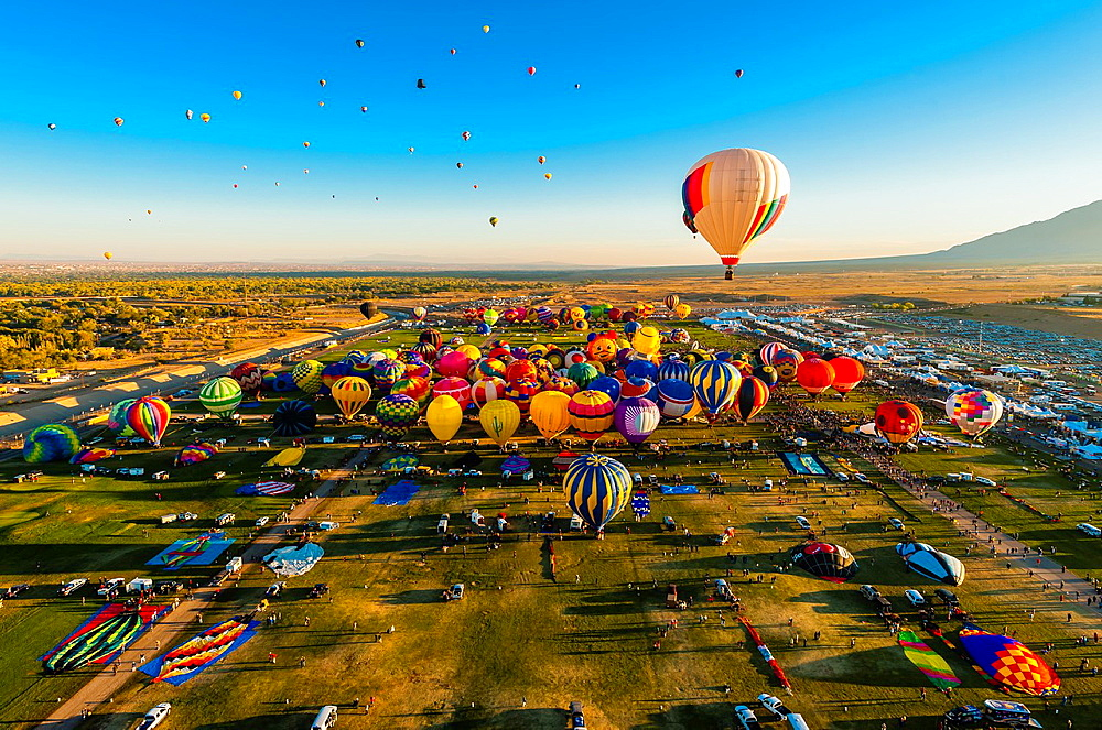 Aerial view, Hot air balloons lifting off from Balloon Fiesta Park, Albuquerque International Balloon Fiesta, Albuquerque, New Mexico USA - 817-417679