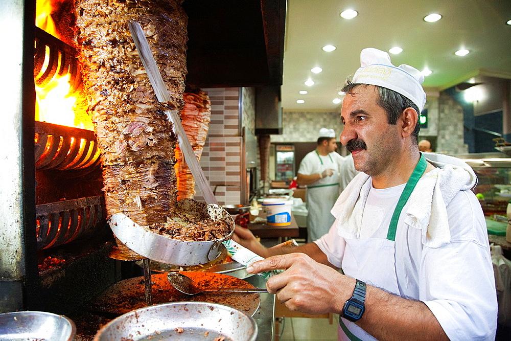 cook cuts the kebab, restaurant, trabzon, black sea, turkey, asia
