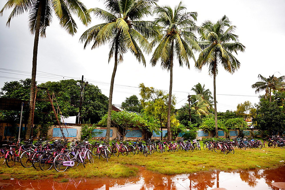 Cochin, India-September 04, 2012  several bicycles parked at the exit of a school getting wet in the monsoon