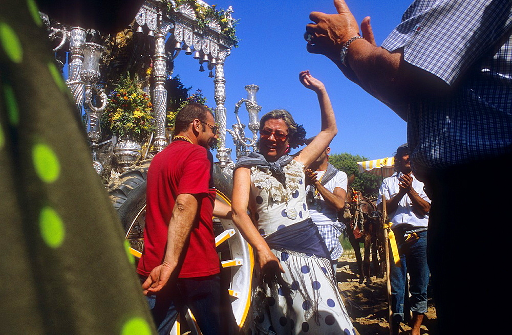 Pilgrims dancing near Cerro de los Ansares,Romeria del Rocio, pilgrims on their way through the Donana National Park, pilgrimage of Sanlucar de Barrameda brotherhood, to El Rocio, Almonte, Huelva province, Andalucia