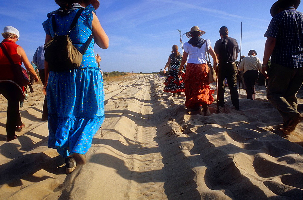 Pilgrims walking near Donana Palace,Romeria del Rocio, pilgrims on their way through the Donana National Park, pilgrimage of Sanlucar de Barrameda brotherhood, to El Rocio, Almonte, Huelva province, Andalucia