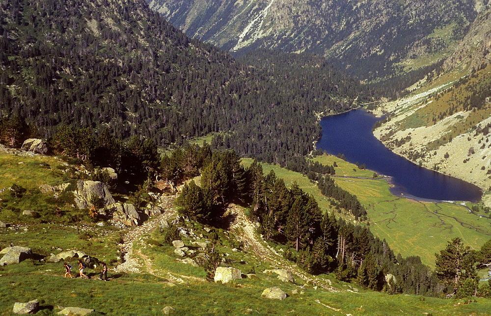 women climbing to `Portarro d¥Espot¥ Espot pass, in background `Estany Llong¥,Llong lake,Aiguestortes i Estany de Sant Maurici National Park,Pyrenees, Lleida province, Catalonia, Spain