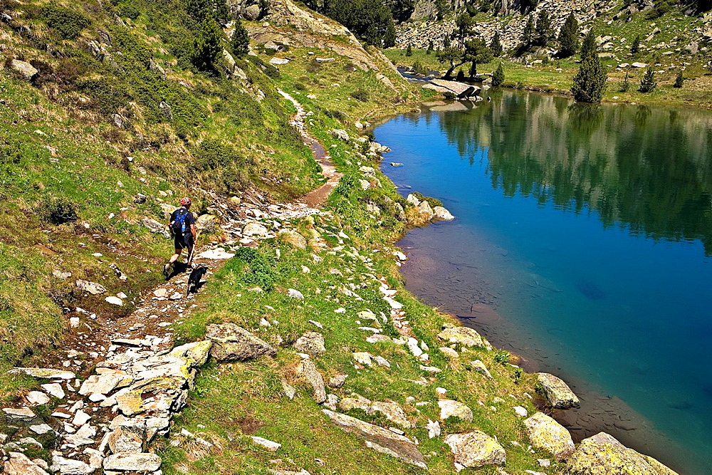 Tripper in Redon lake,Colomers cirque,Aran Valley, Aiguestortes and Estany de Sant Maurici National Park,Pyrenees, Lleida province, Catalonia, Spain