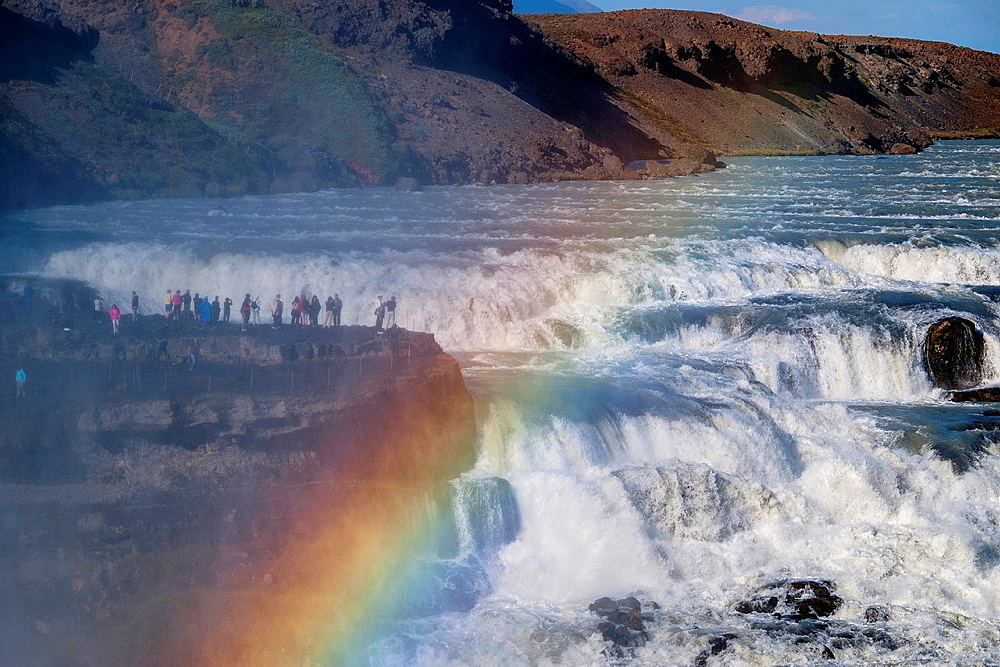 People on the edge of the waterfall of Gullfoss, one of the largest and mighty waterfalls of Iceland  Golden Circle  Southeast Iceland  Iceland, Scandinavia, Europe