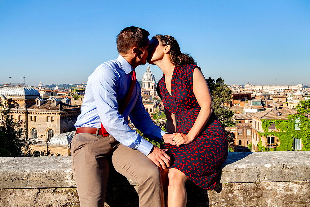 Couple kissing in the city of Rome Italy