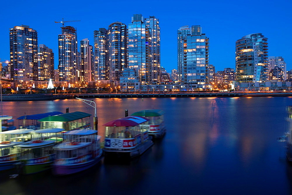 Vancouver skyline with boats at Granville Island