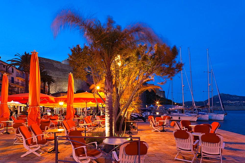 France, Corsica, Haute-Corse Department, La Balagne Region, Calvi, Port de Plaissance, yacht harbor, waterfront cafe, dusk