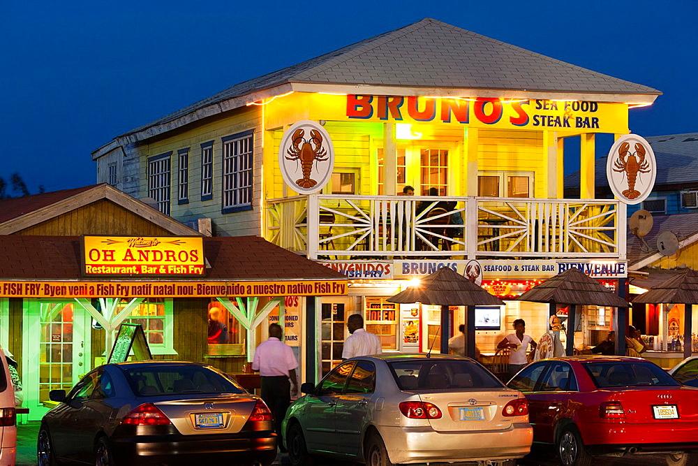 Bahamas, New Providence Island, Nassau, Arawak Cay, fish fry restaurants, signs, dusk