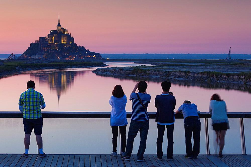 France, Normandy Region, Manche Department, Mont St-Michel, Le Barrage du Mont Saint Michel dam, dusk, silhouettes of people, NR