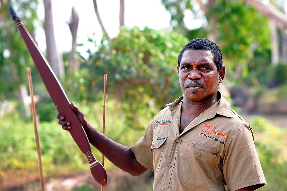 Aboriginal Tour Guide demonstrating a Woomera spear throwerin Kakadu National Park Northern Territory, Australia
