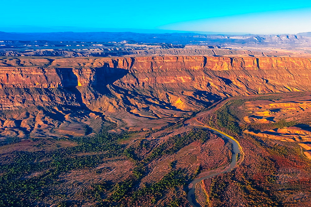 Aerial view from Big Bend National Park, Texas USA across the Rio Grande River to the Santa Elena Escarpment in Mexico Mexico is on the left side of the river - 817-421138