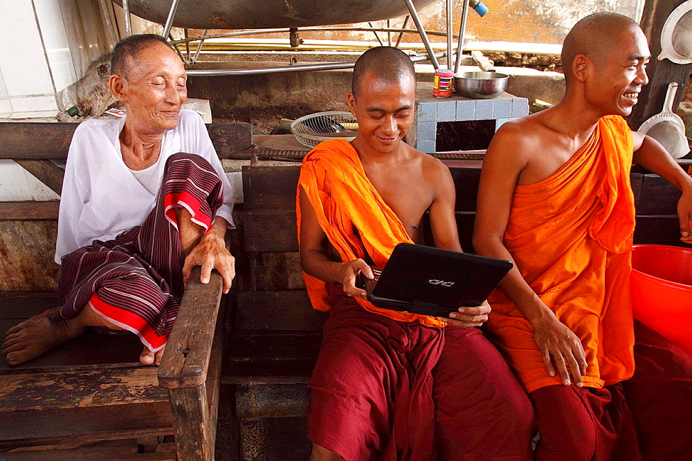 Three monks Siteting having a chat and watching movie, , Myanmar, Burmaa, Asia
