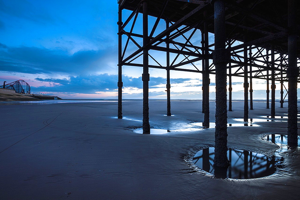 England, Lancashire, Blackpool Underneath the Blackpool South Pier, looking towards the Blackpool Pleasure Beach