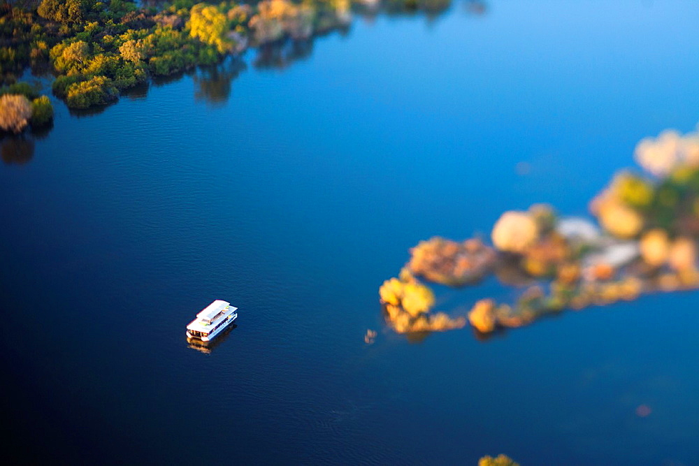 Aerial view of the Zambezi river with riverboat