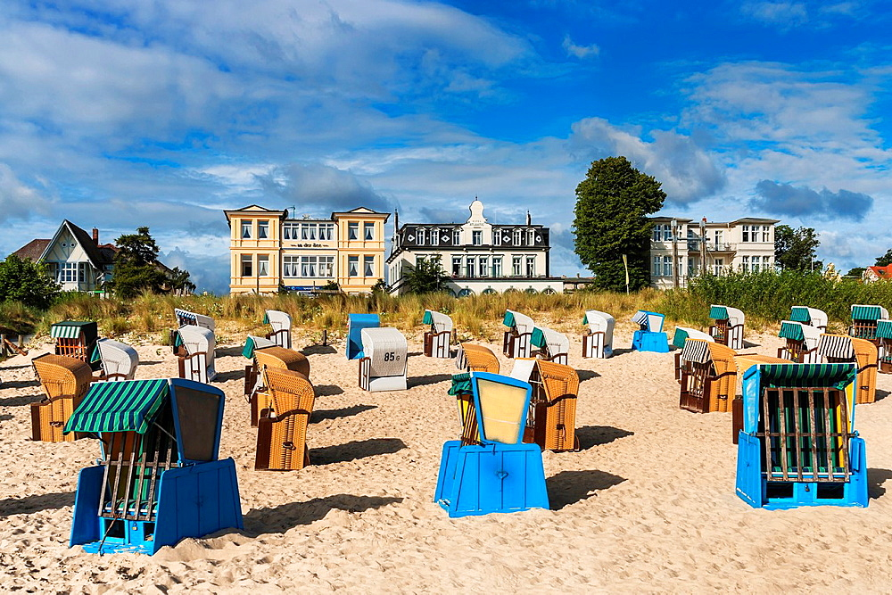 Beach chairs at the Baltic Sea beach, Baltic resort Bansin At the Seaside promenade are the 'Pension at the sea' and 'Hotel Atlantic' Usedom Island, County Vorpommern-Greifswald, Mecklenburg-Western Pomerania, Germany, Europe