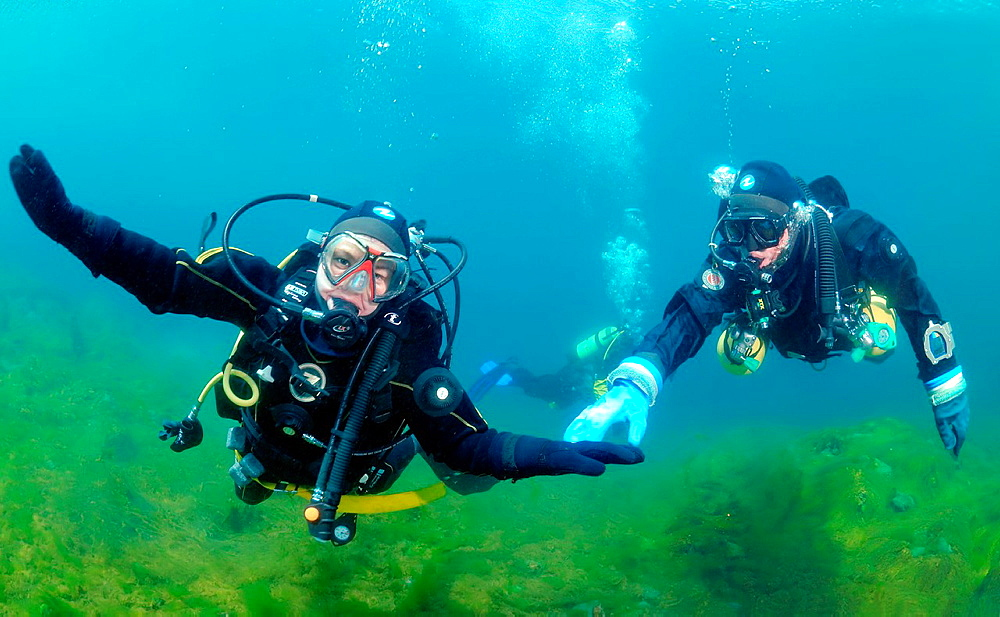 Diving the instructor trains beginning scuba diver to hold neutral buoyancy, Lake Baikal, Siberia, Russian Federation
