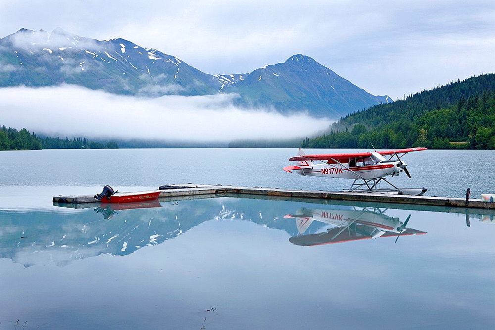 Float plane and boat beside dock, Upper Trail Lake, Moose Pass, Kenai Peninsula, Alaska, USA, late August