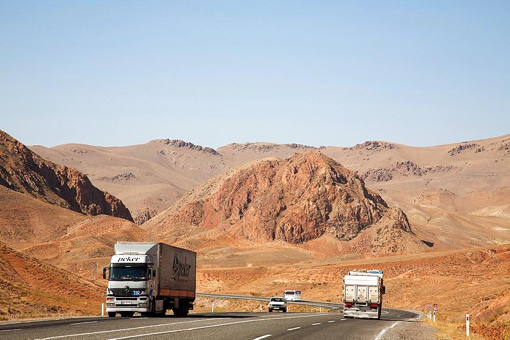 road and truks, landscape, area west of lake van, eastern anatolia, turkey, asia
