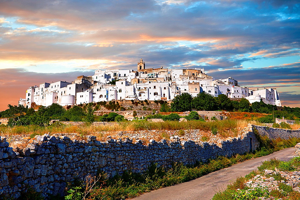 The medieval white fortified hill town walls of Ostuni, The White Town, Puglia, Italy