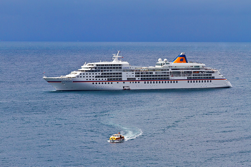 The cruise ship Europa with tender boat off the coast of Sorrento, Campania, Italy