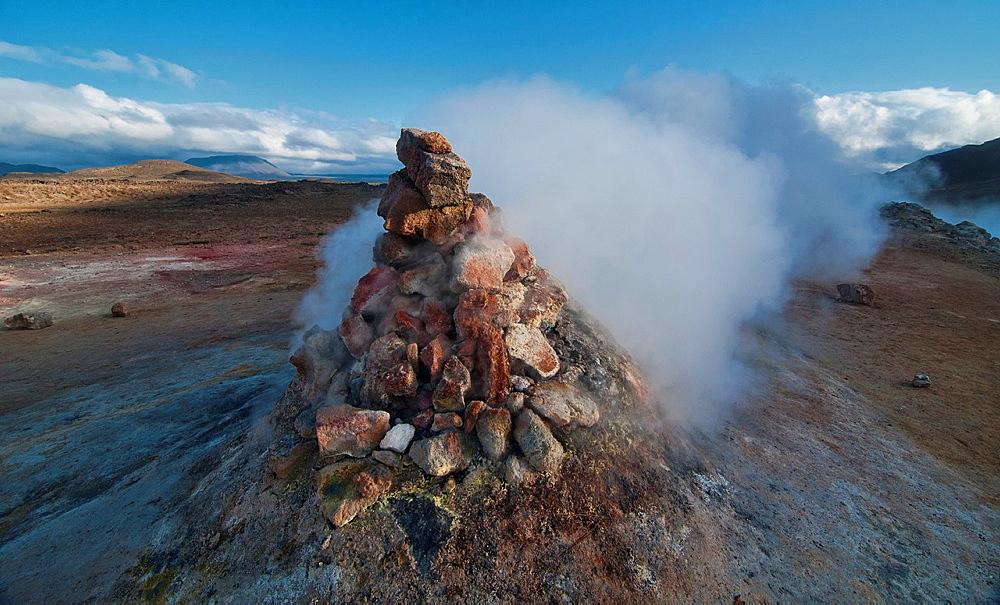 smoking fumaroles at the geothermal area of Hverir near Lake Myvatn, Iceland