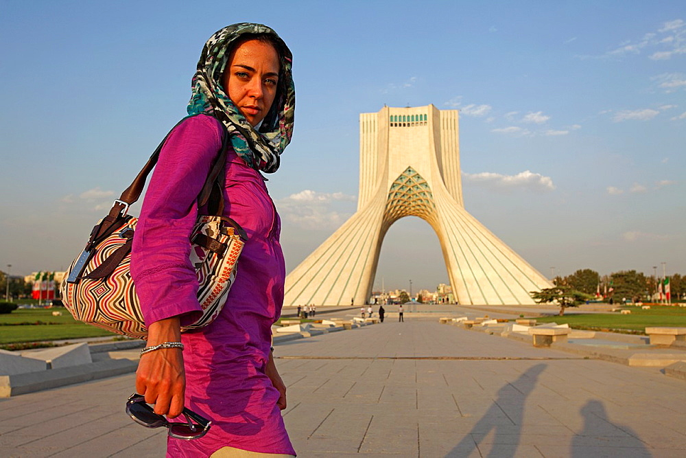 Caucasian woman at Azadi Tower, or King Memorial Tower, Teheran, Iran