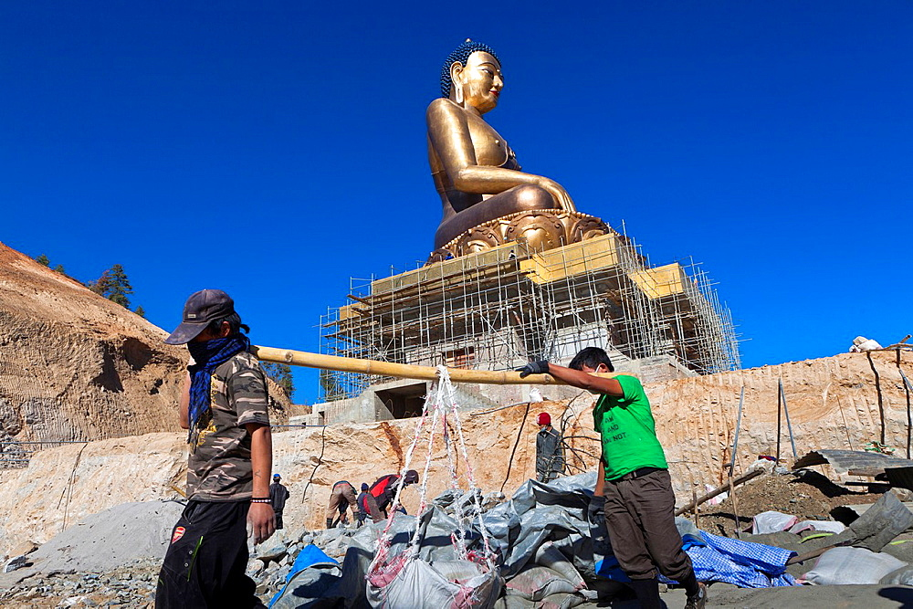 Workers in the cosnstruction of the Giant Buddha Dordenma Statue in Kuensel Phodrang, Thimphu, Bhutan, Asia.
