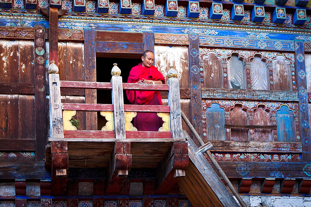 Monk in Wangdichholing Palace built in 1857 as the Kingdomís first palace, Bumthang, Bhutan, Asia.