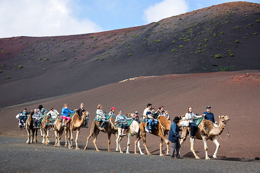 Spain, Canary Islands, Lanzarote Island, Timanfaya National Park, tourists on camels