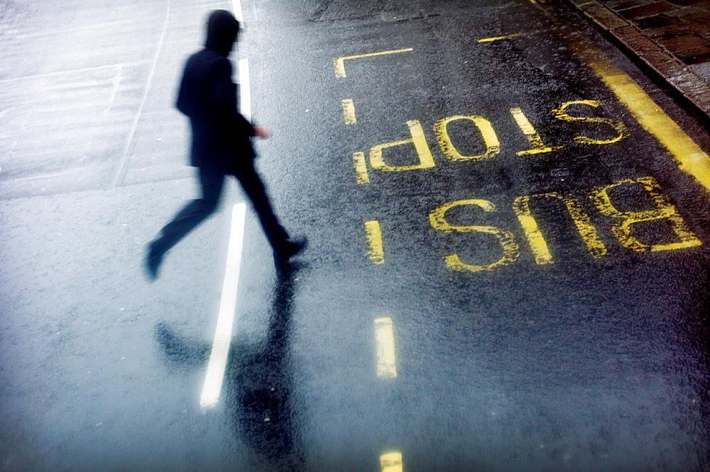 man running across a street