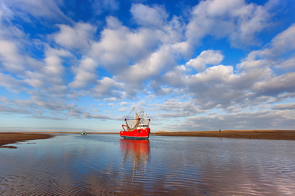 Fishing Boat Brancaster harbour mouth North Norfolk UK Winter