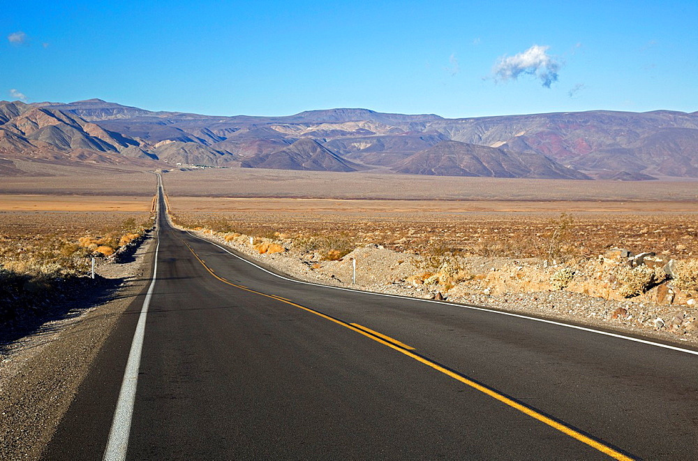 Death Valley National Park, California, California Highway 190 leads across a deserted Panamint Valley towards the Panamint Mountains