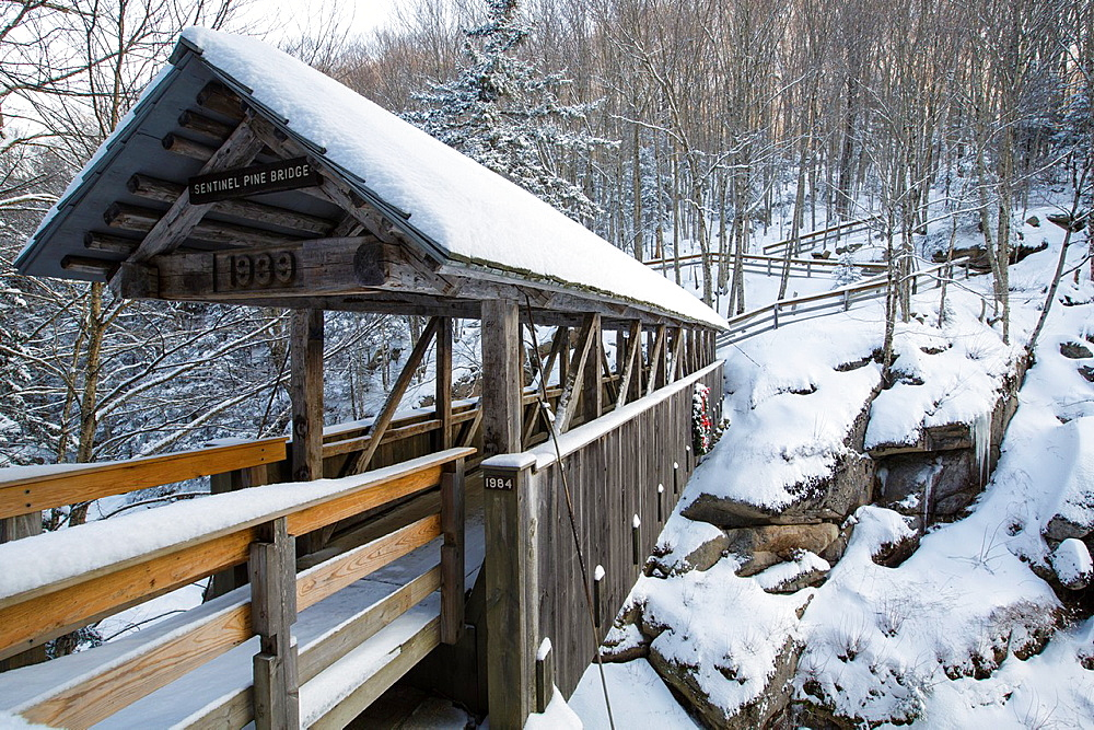 Franconia Notch State Park, Sentinel Pine Covered Bridge during the winter months It is a footbridge which crosses over the Pemigewasset River in Lincoln, New Hampshire, USA