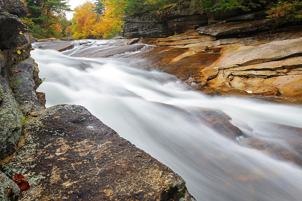 Lower Ammonoosuc Falls in Carroll, New Hampshire USA during autumn months These falls are located along the Ammonoosuc River
