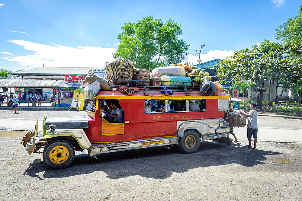 Overloaded jeepney starting the journey at Puerto Princesa bus station, Palawan, Philippines