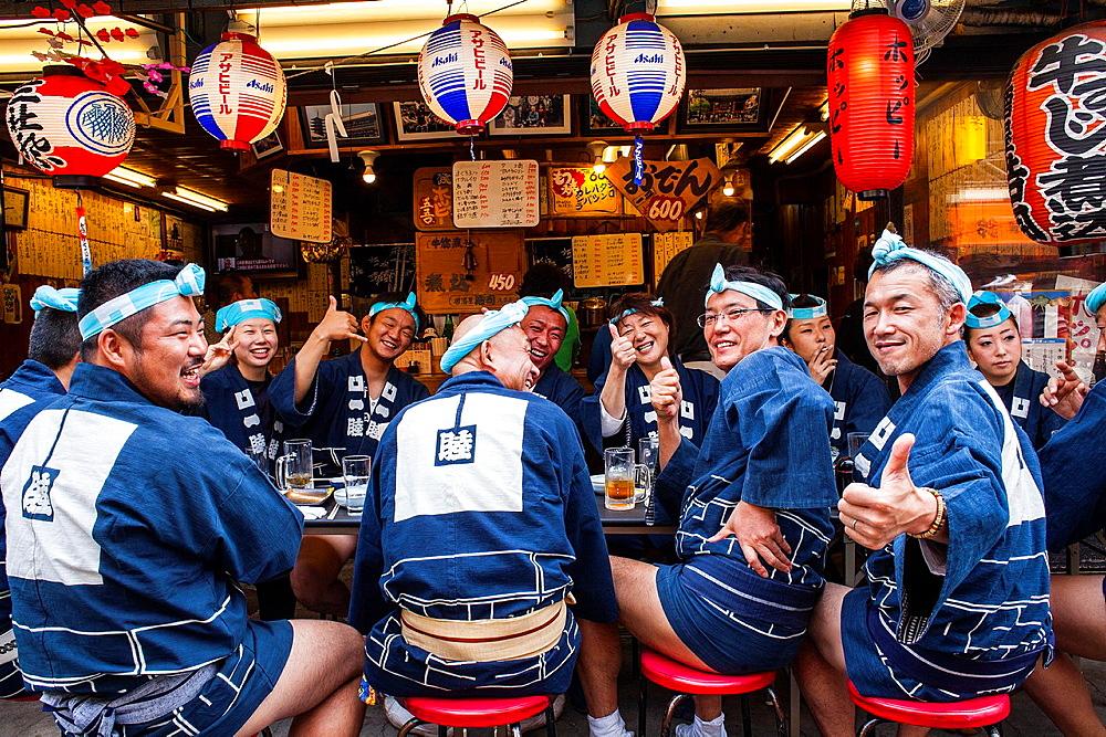 Bearers of Mikoshi eating in restaurant,during Sanja Matsuri Festival, in 2 chome street, Asakusa, Tokyo, Japan, Asia