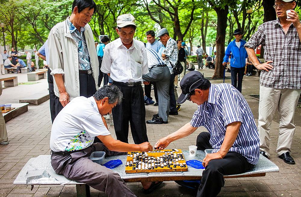 Men playing Baduk at Jongmyo park, Seoul, South Korea