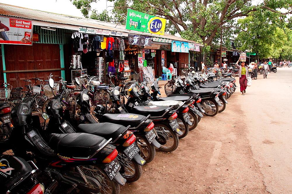 Motorcycles parking in a line, Myinkaba market, Old Bagan, Pagan, Burma, Myanmar, Asia