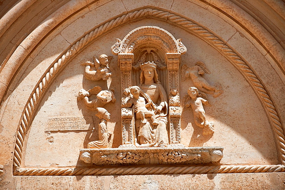 The Italian Gothic medieval relief sculptures of the Madonna & Child over the main door of the Cathedral of Ostuni built between 1569-1495 Ostuni, The White Town, Puglia, Italy