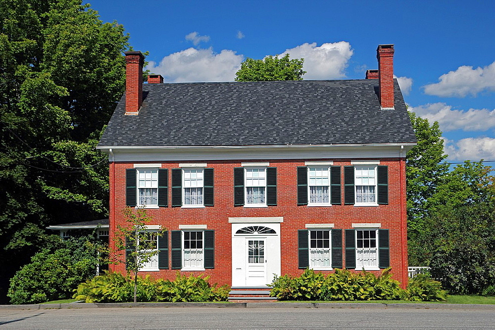 A brick home in the town of Belfast, Maine