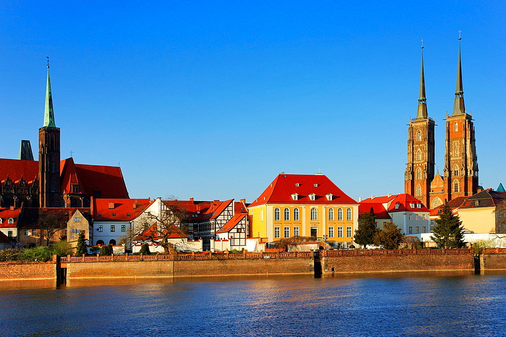 View over the Oder river to dome island, the Dome and the Church of the Holy Cross, Wroclaw county, Voivodeship Lower Silesian, Poland, Europe