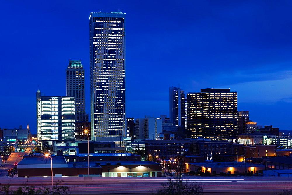 USA, Oklahoma, Tulsa, city skyline from highway I-244, dusk