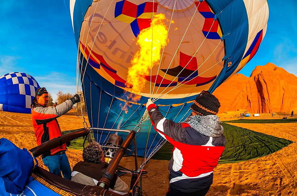 Inflating hot air balloons at the Red Rock Balloon Rally, Red Rock State Park, near Gallup, New Mexico USA