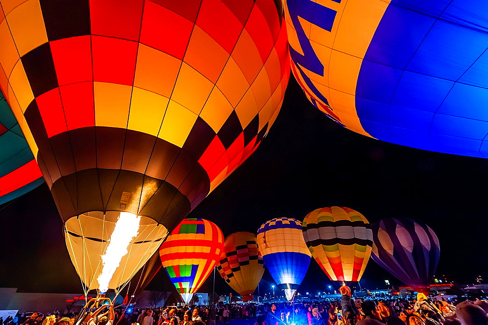 Evening balloon glow at Rio West Mall, during the Red Rock Balloon Rally, Gallup, New Mexico USA