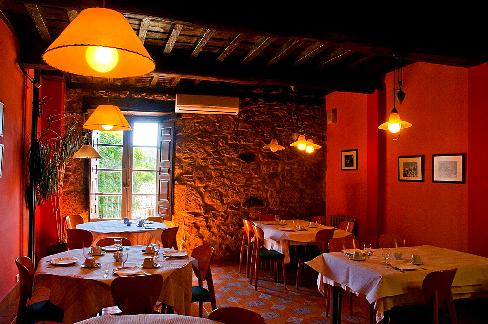 Set tables for breakfast in a rural hotel. Candelario, Salamanca province, Castilla Leon, Spain.