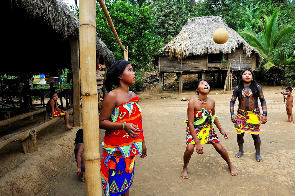 young girls playing football on a village's square of Embera native community living by the Chagres River within the Chagres National Park, Republic of Panama, Central America - 817-430554