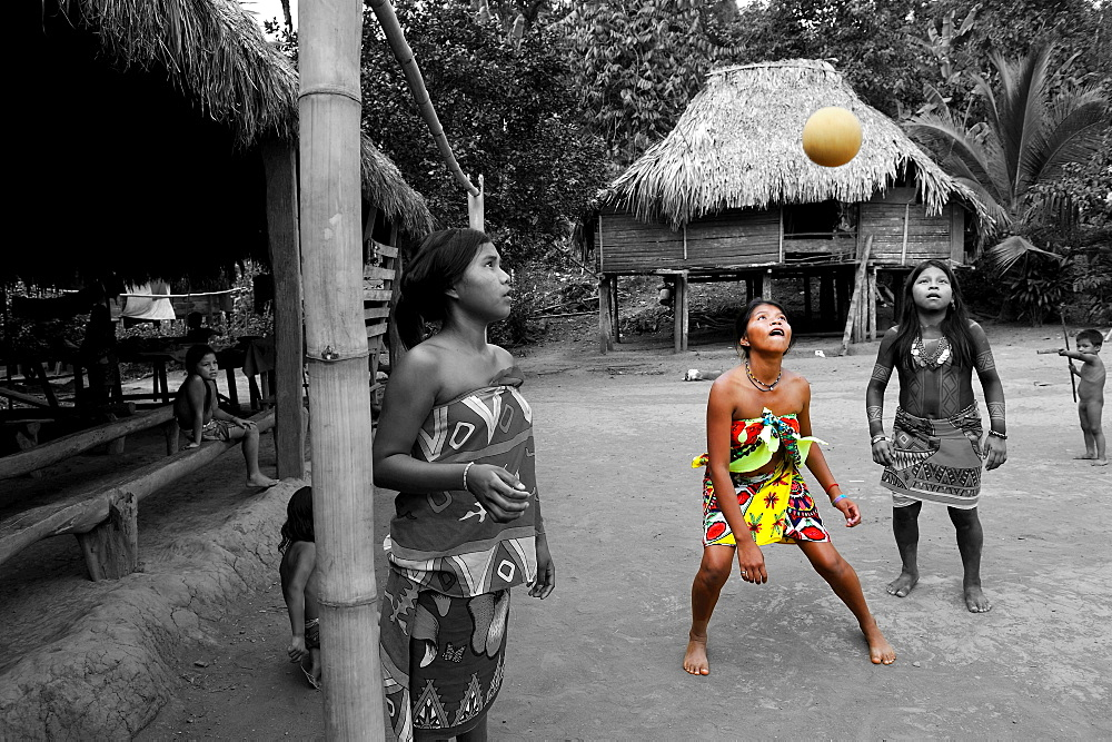 young girls playing football on a village's square of Embera native community living by the Chagres River within the Chagres National Park, Republic of Panama, Central America - 817-430554B