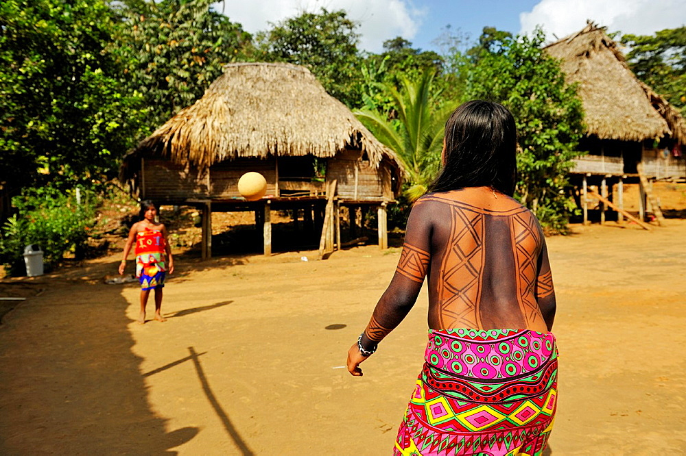 young girls playing football on a village's square of Embera native community living by the Chagres River within the Chagres National Park, Republic of Panama, Central America - 817-430555